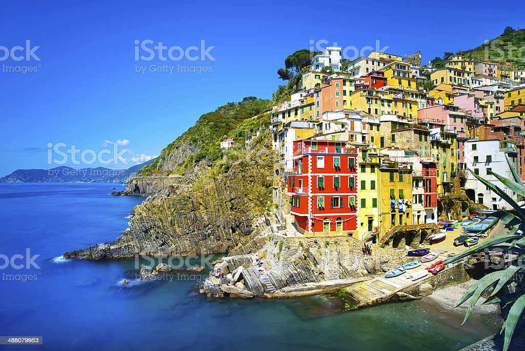 Riomaggiore village, rocks and sea at sunset. Cinque Terre, Ligu stock photo