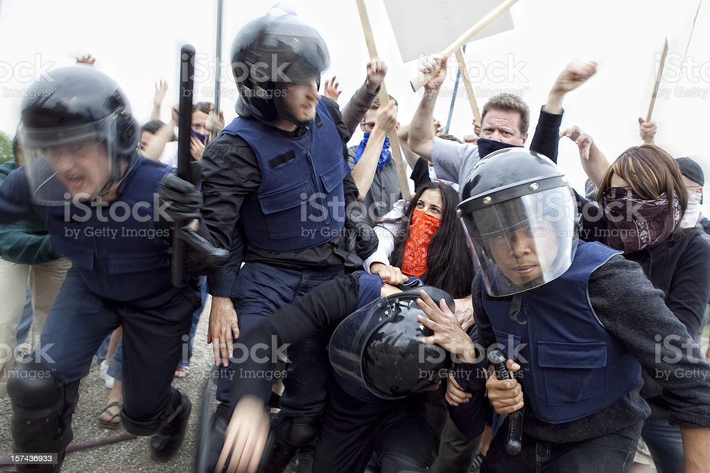 Riot Police Fight Angry Mob stock photo