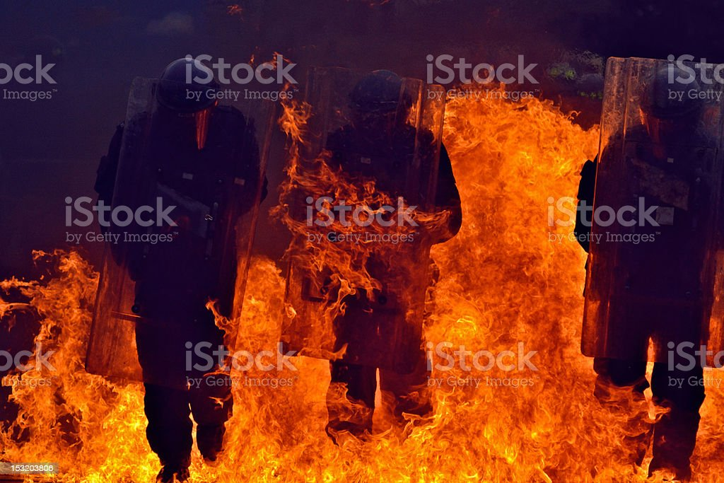 UK Riot Police Flames royalty-free stock photo
