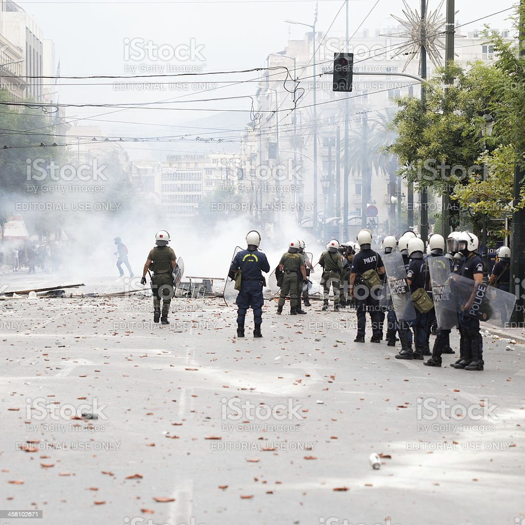Riot police in Athens clash with protesters stock photo