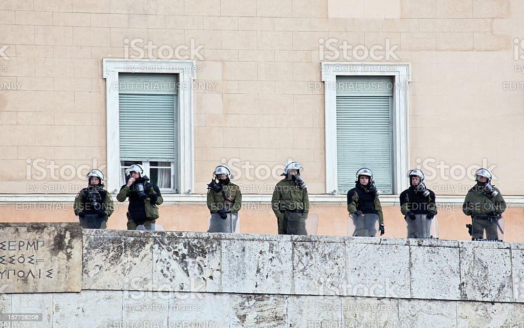 Riot police in front of greek parliament building stock photo
