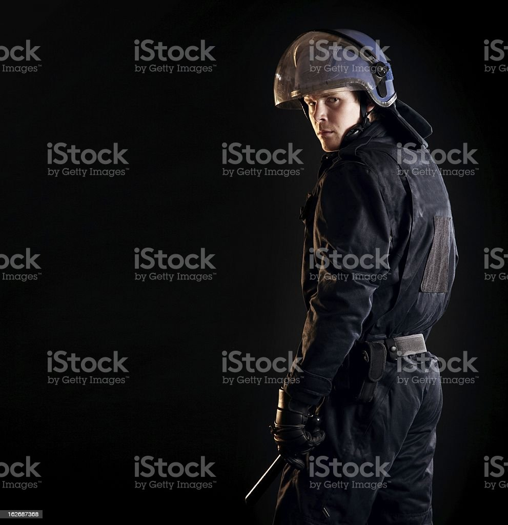 Riot Police Officer in the Dark royalty-free stock photo