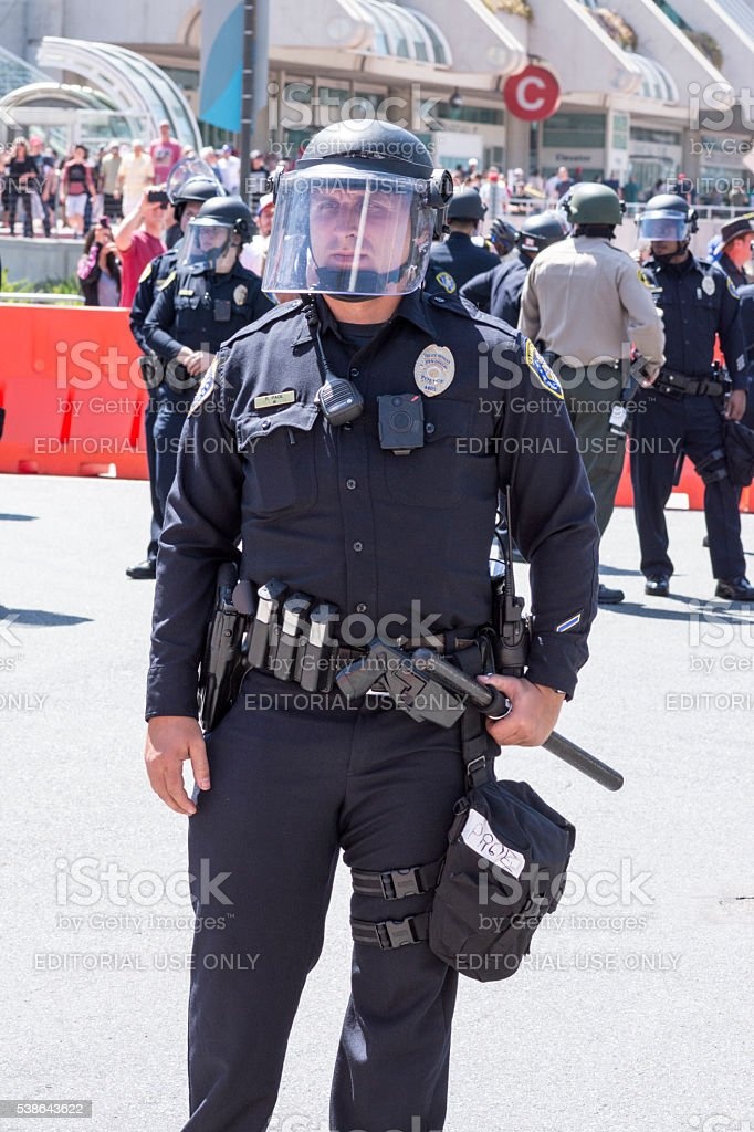 Riot police officer ready for action stock photo