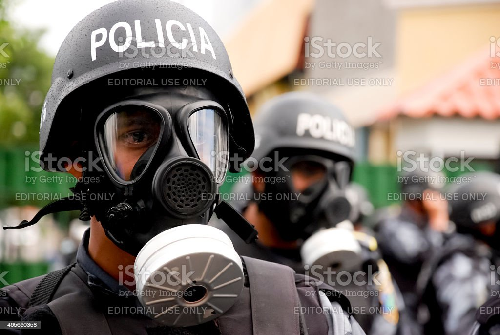 Riot police with anti-gas mask stock photo