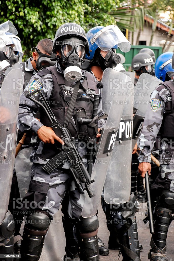 Riot police with shields and masks stock photo