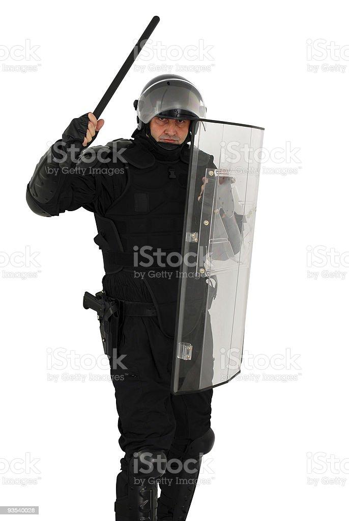 riot policeman attacking stock photo