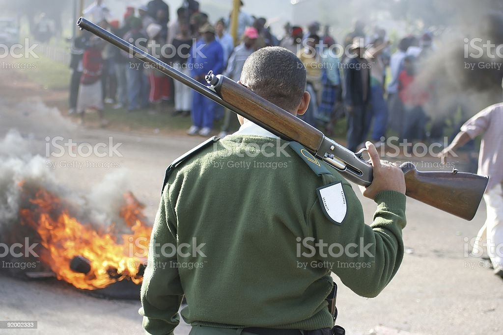 Rioters, guard and fire stock photo
