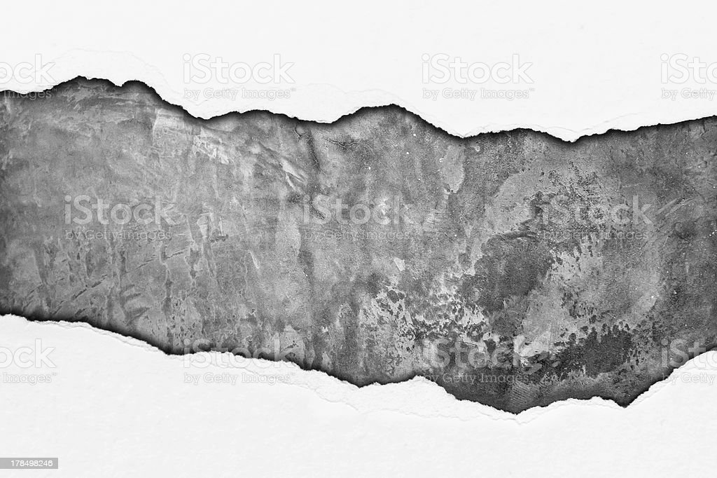 Rip paper on grunge cement wall royalty-free stock photo