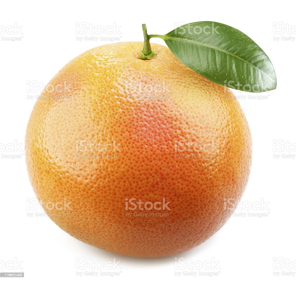 Ripe appetizing grapefruit with leaf. stock photo