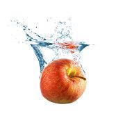 Ripe apple fall into water