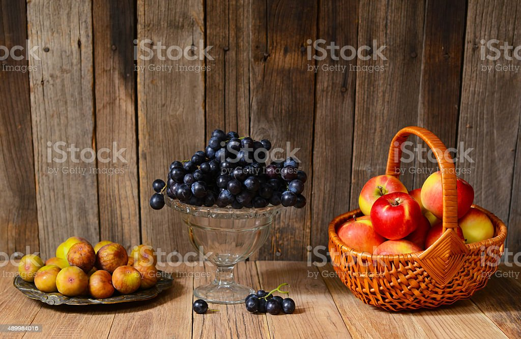 Ripe apples, grapes and figs stock photo