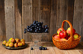 Ripe apples, grapes and figs