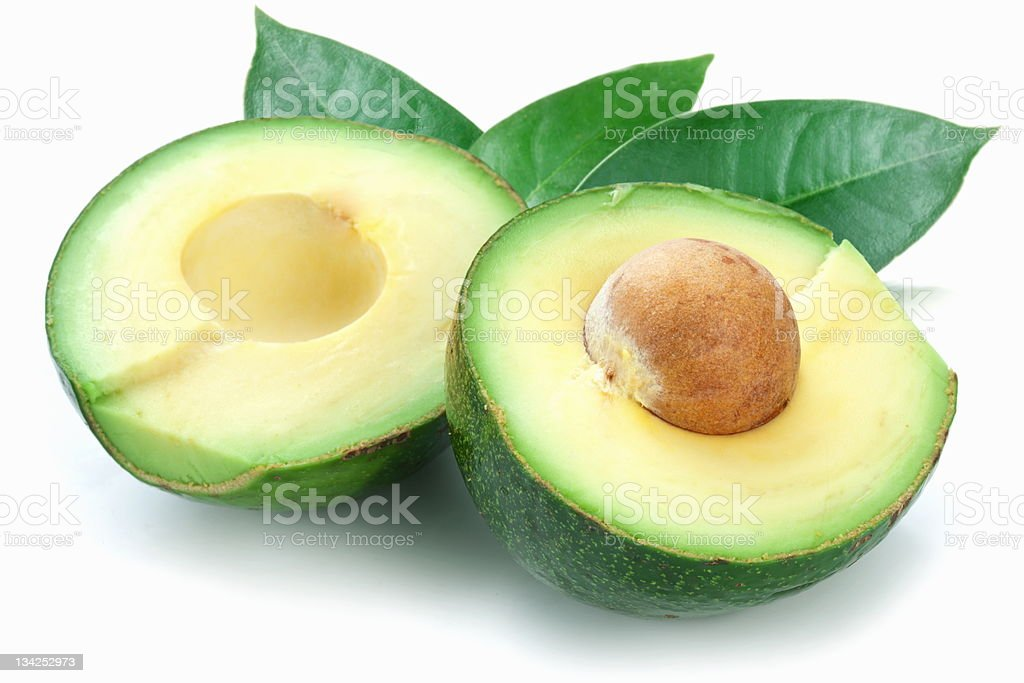 Ripe avacados with leaves. royalty-free stock photo