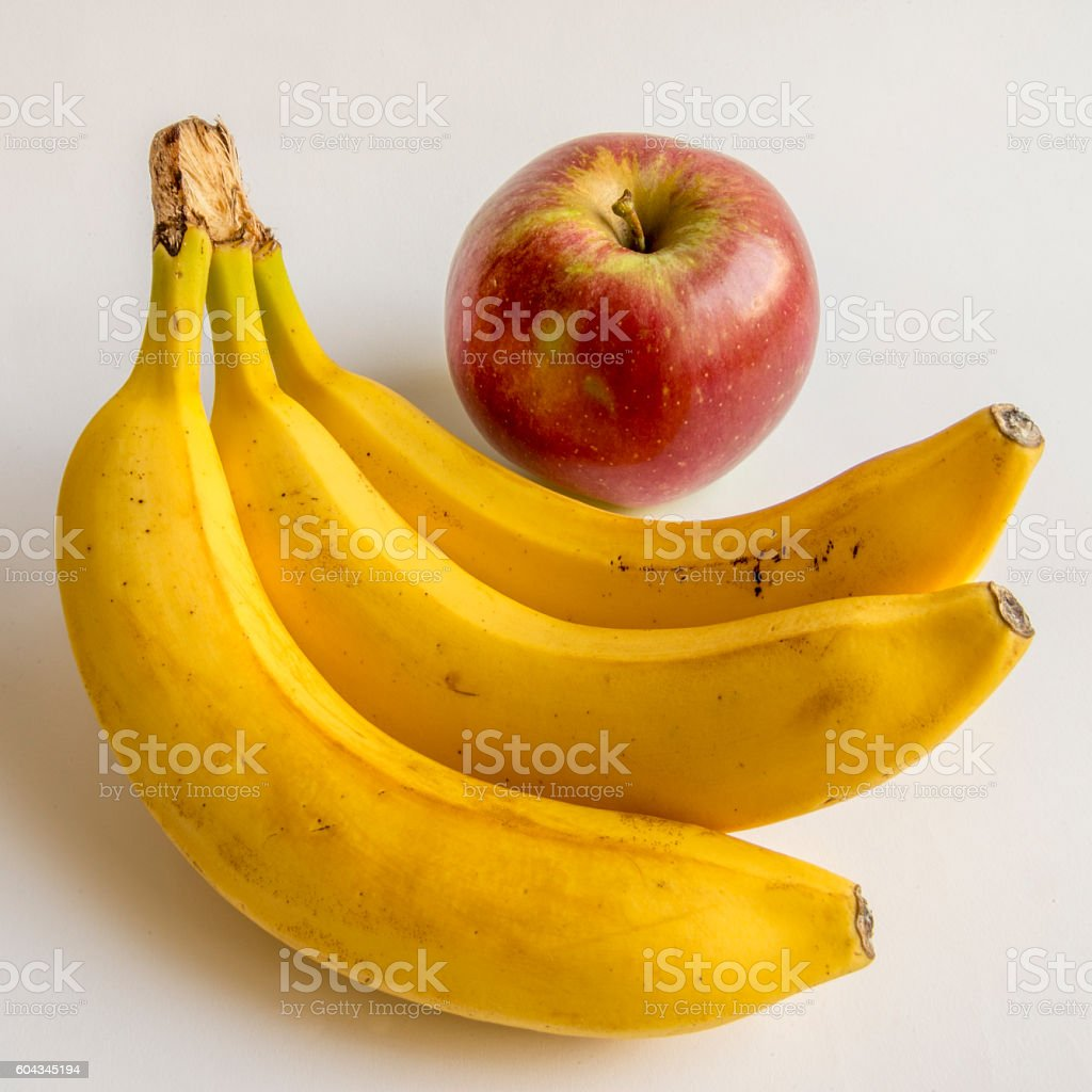 ripe bananas and apple isolated on a white background stock photo