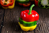 Ripe bell pepper on wood background