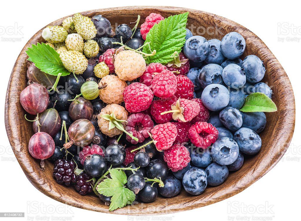 Ripe berries in the wooden bowl. stock photo