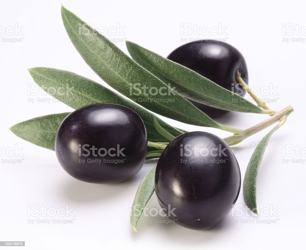 Ripe black olives with leaves. stock photo