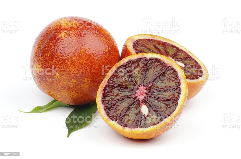 Ripe blood oranges, one cut in half, on white background stock photo