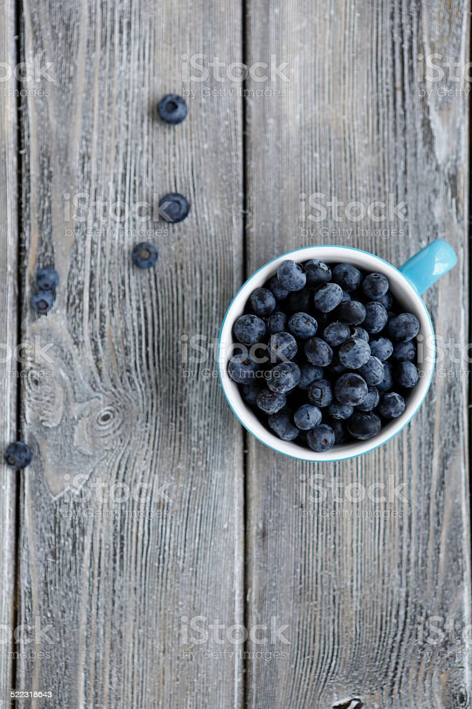 Ripe blueberries in the cup stock photo