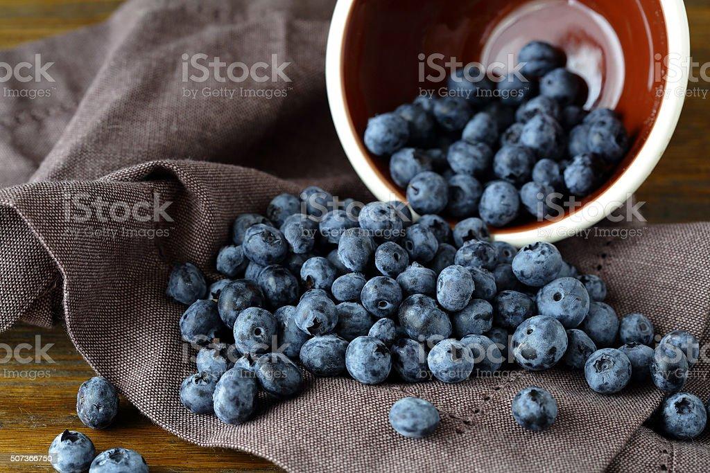 ripe blueberries on napkin stock photo