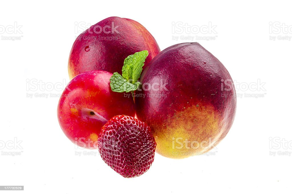 Ripe bright peaches, plum, strawberry and mint royalty-free stock photo