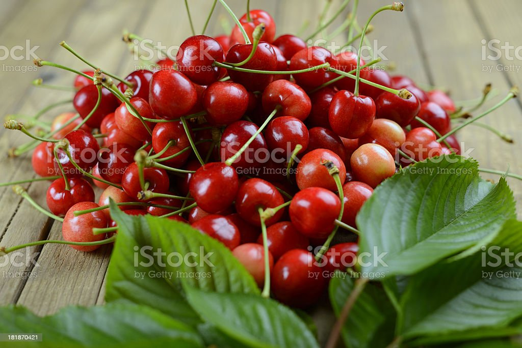 Ripe cherries on wooden old table royalty-free stock photo