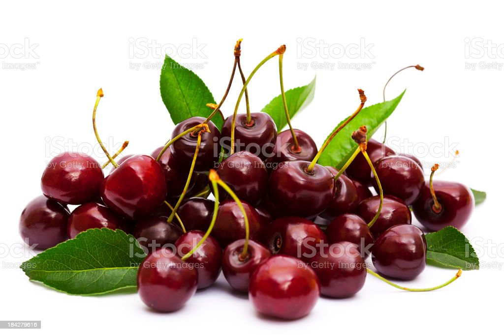 Ripe cherries with stalks and leaves on white background stock photo