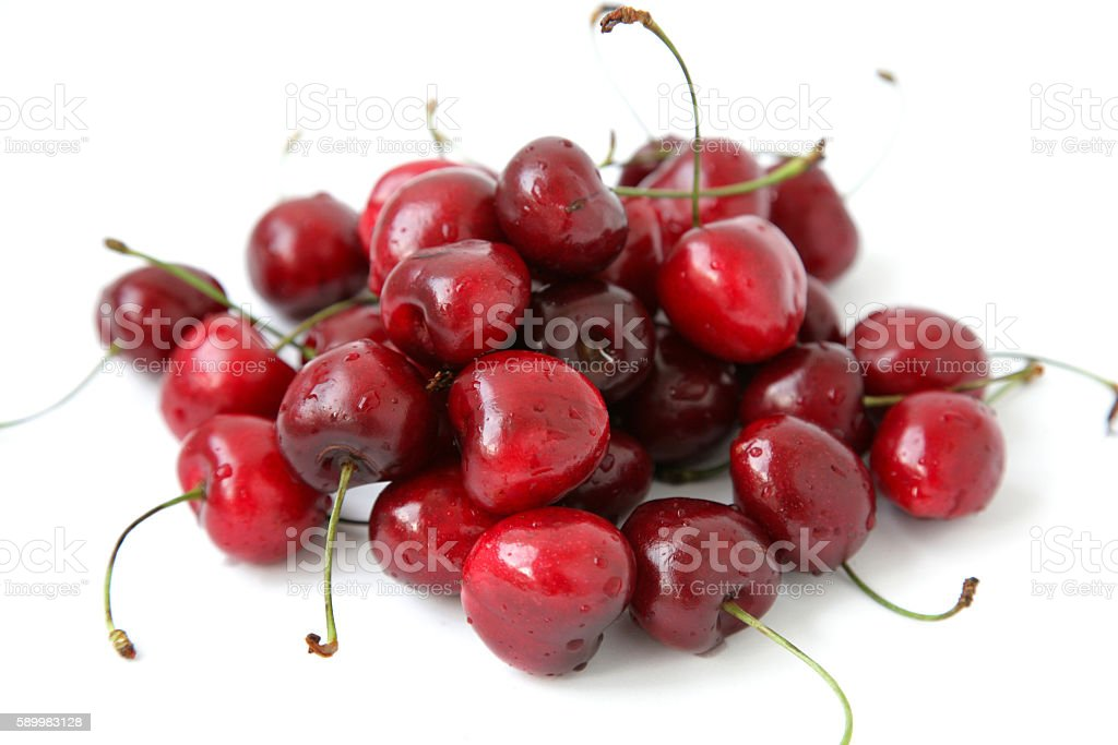 Ripe cherry on a white background with drops of water stock photo
