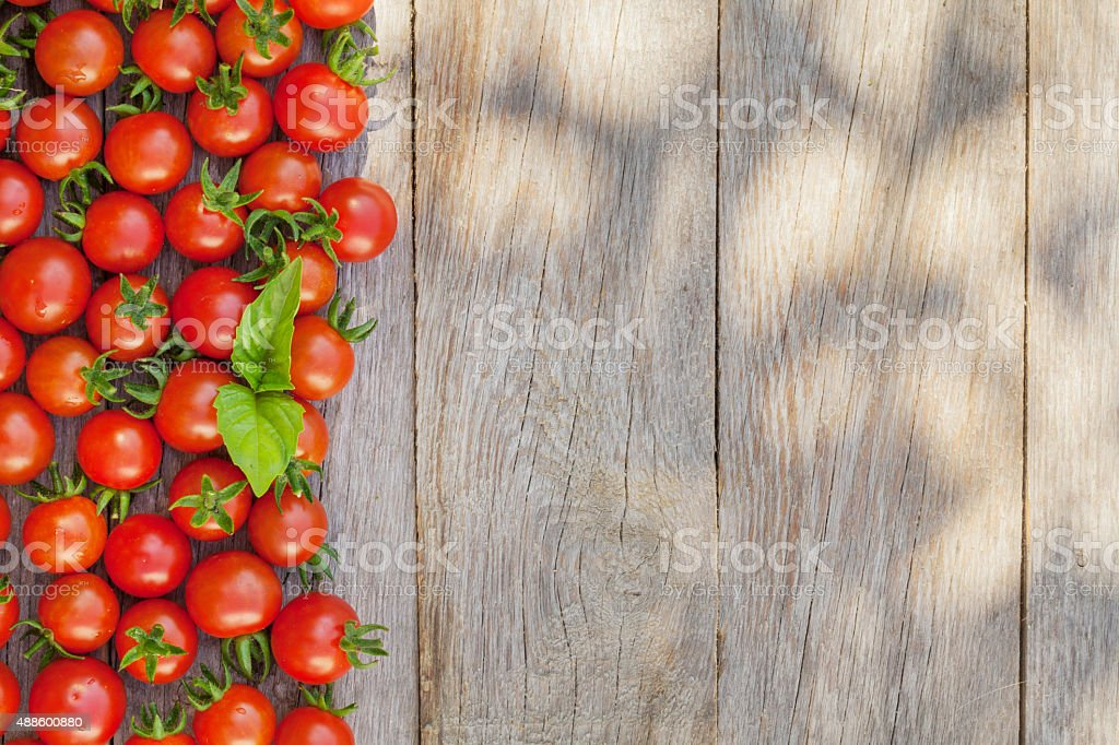Ripe cherry tomatoes and basil stock photo
