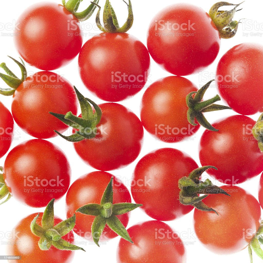 Ripe cherry tomatoes lit from behind royalty-free stock photo