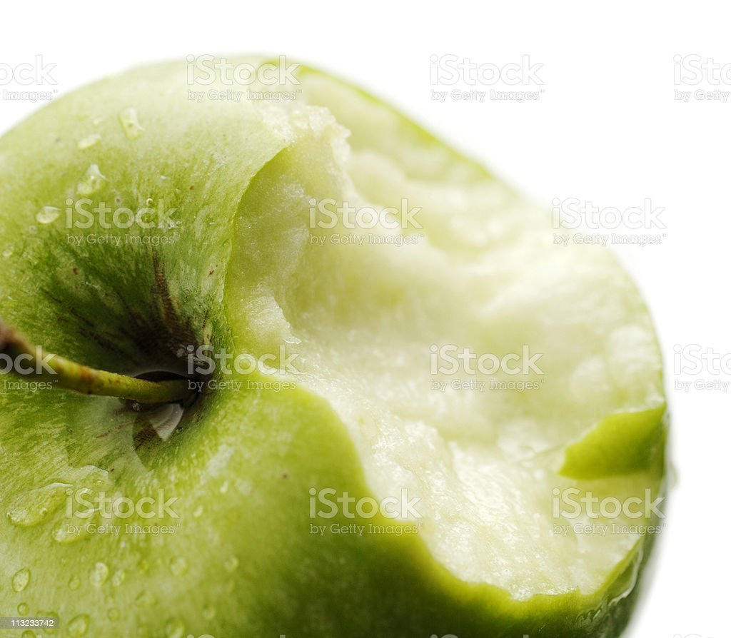 ripe crisp juicy green apple with chunk missing against white stock photo