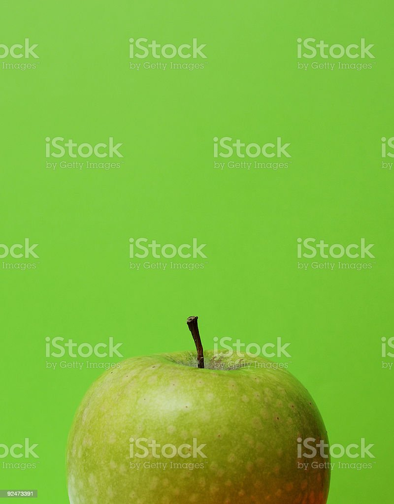ripe crisp organic apple against green background royalty-free stock photo