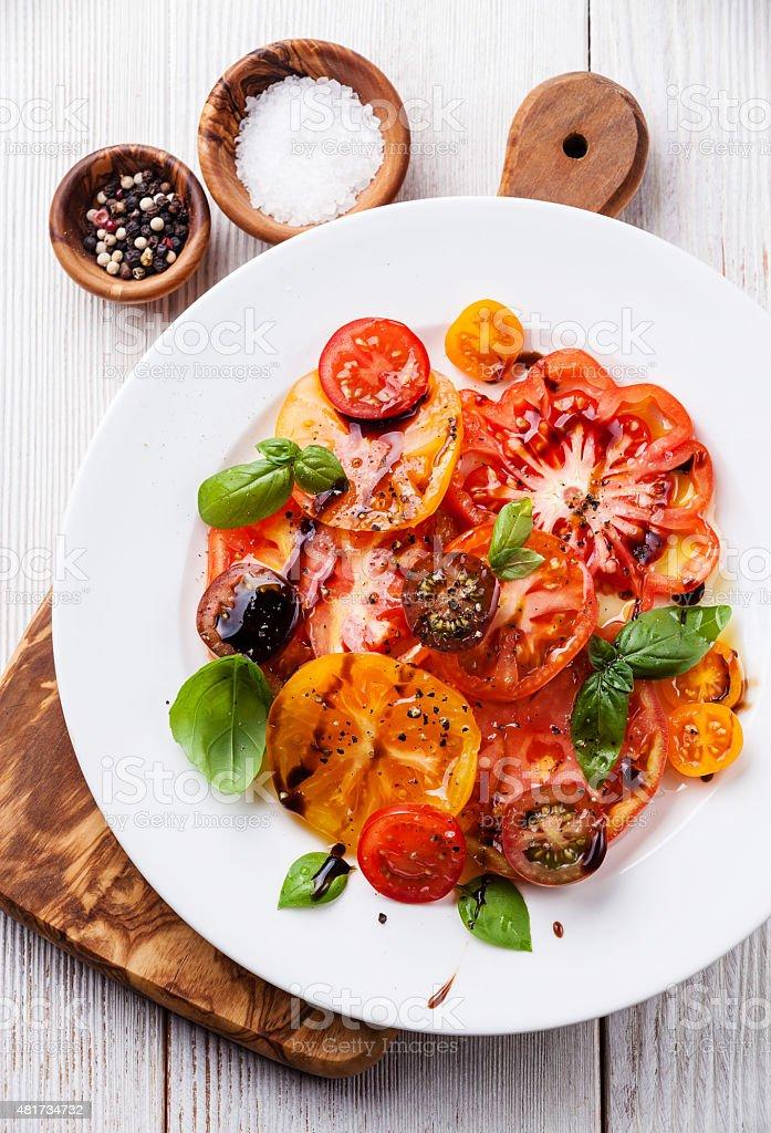 Ripe fresh colorful tomatoes salad stock photo