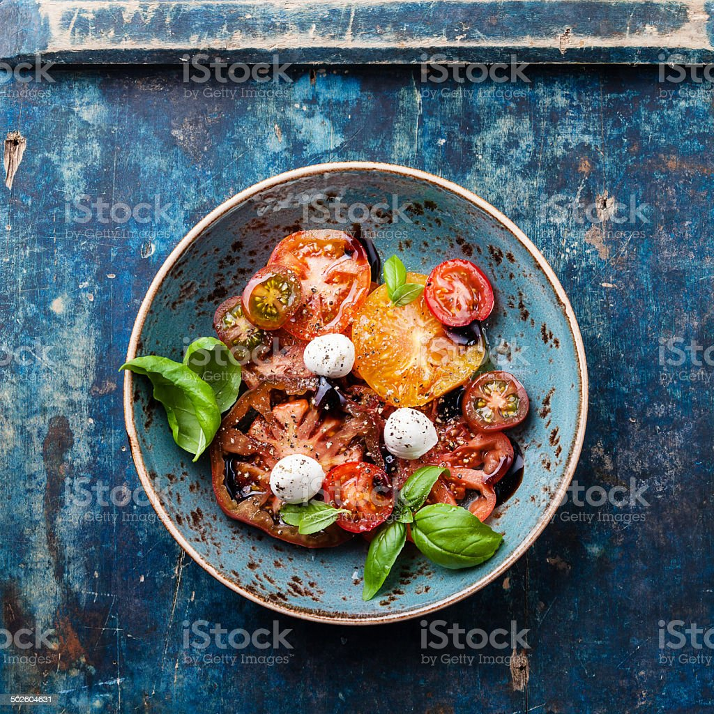 Ripe fresh colorful tomatoes salad stock photo