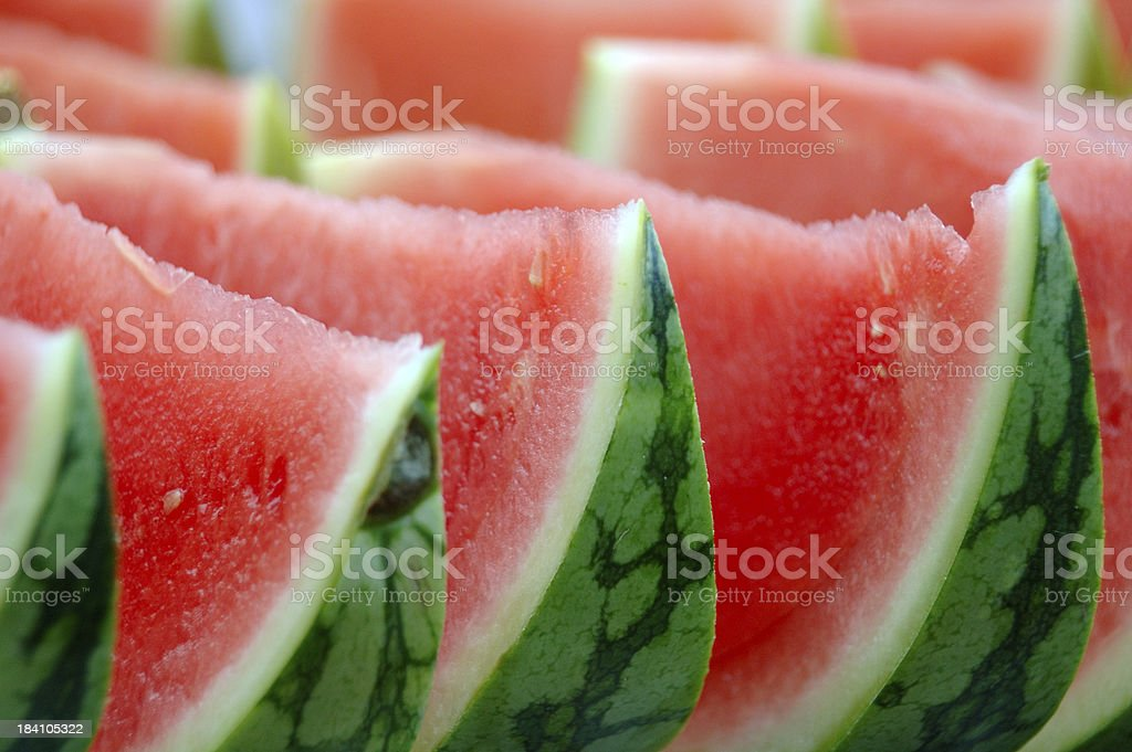 Ripe, fresh watermelon lined up and ready to eat royalty-free stock photo