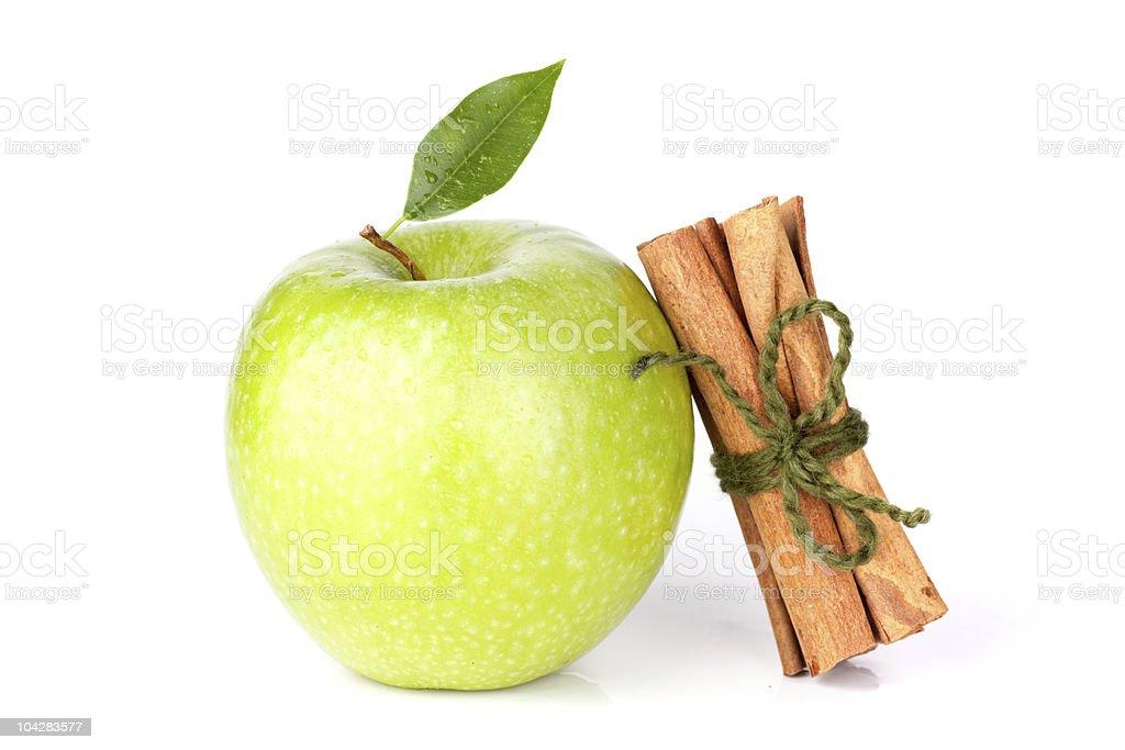 Ripe Green Apple with cinnamon sticks stock photo