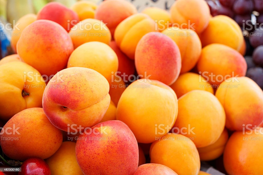 Ripe healthy apricot displayed at the street market stock photo