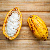 Ripe Indonesia's cocoa  setup on rustic wooden background.