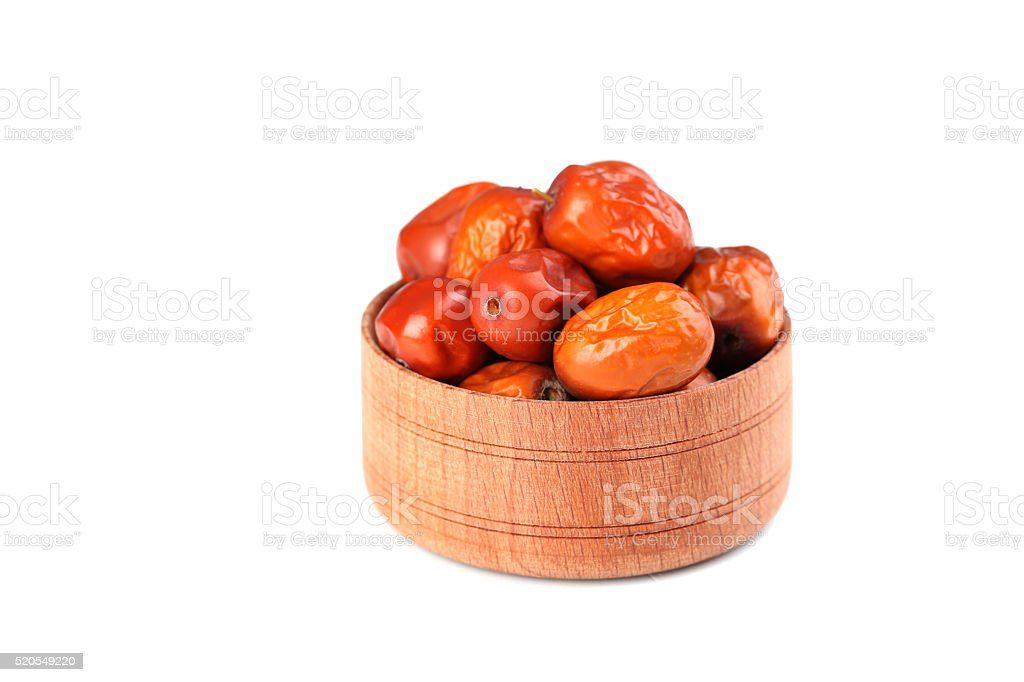 Ripe jujubes in bowl isolated on a white stock photo