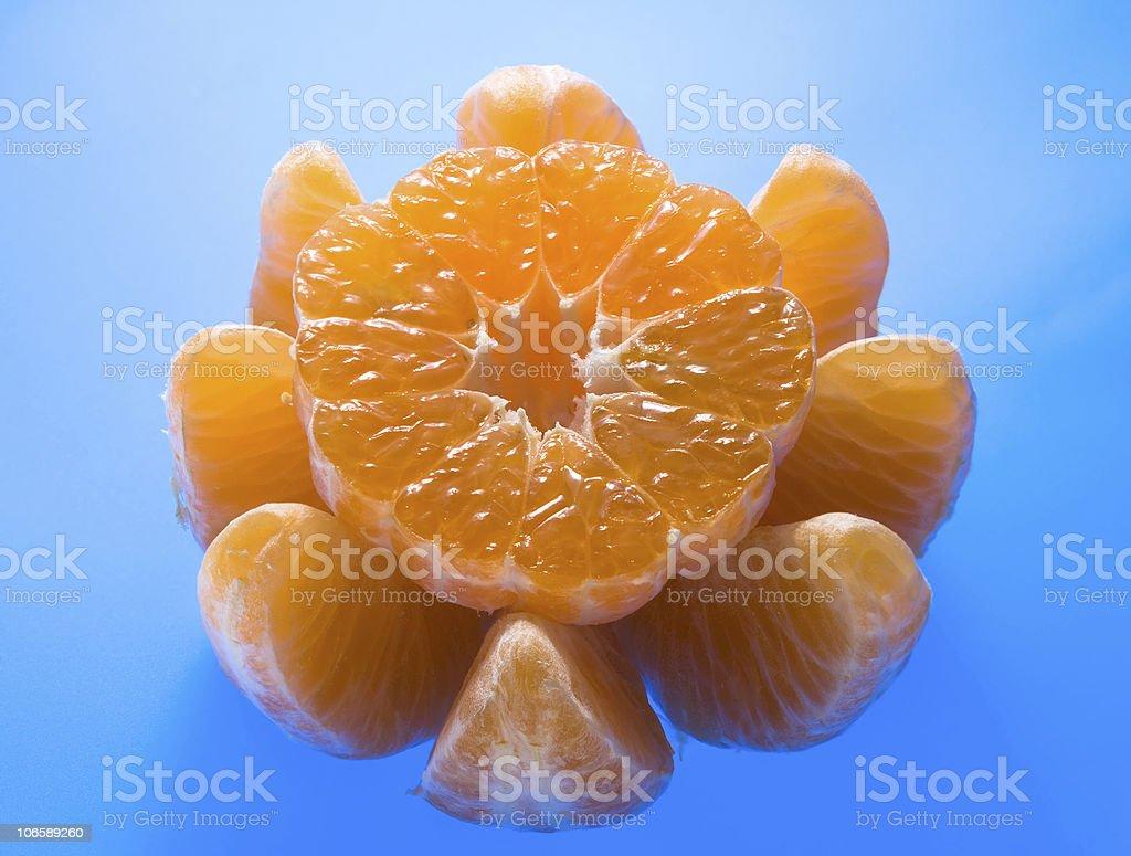 Ripe mandarin on blue background stock photo