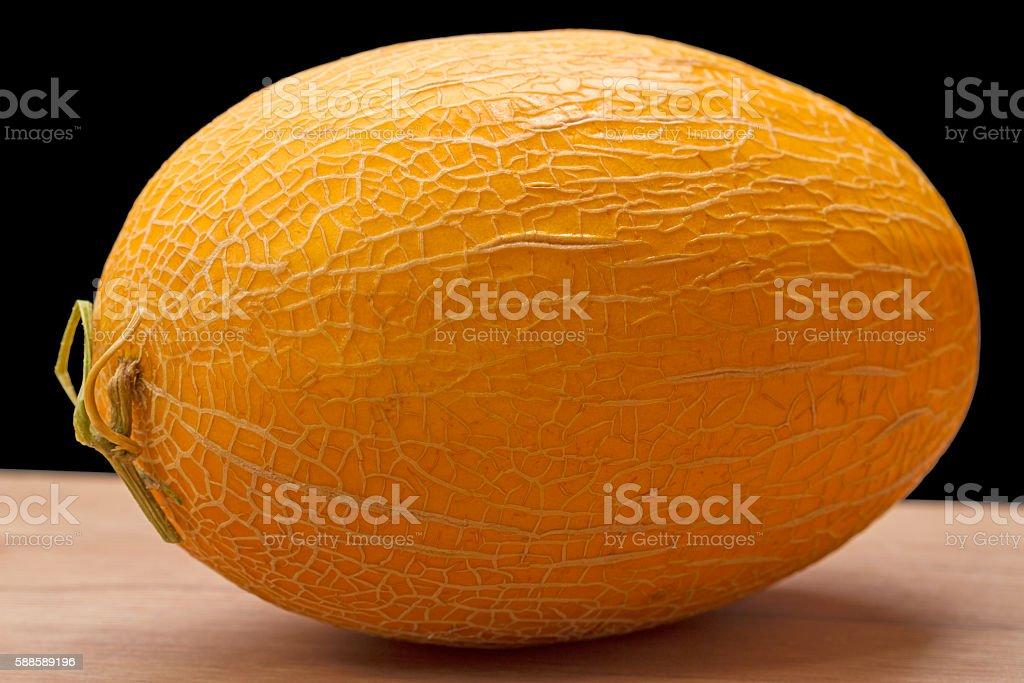 Ripe melon on black stock photo
