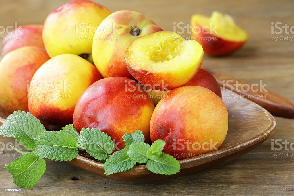 ripe nectarine peaches on wooden table royalty-free stock photo