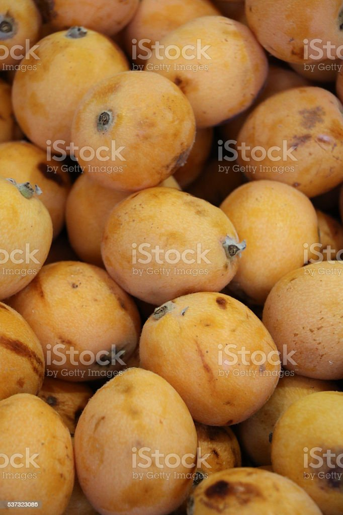 Ripe Nespolo at the fruit and vegetable market, Italy stock photo