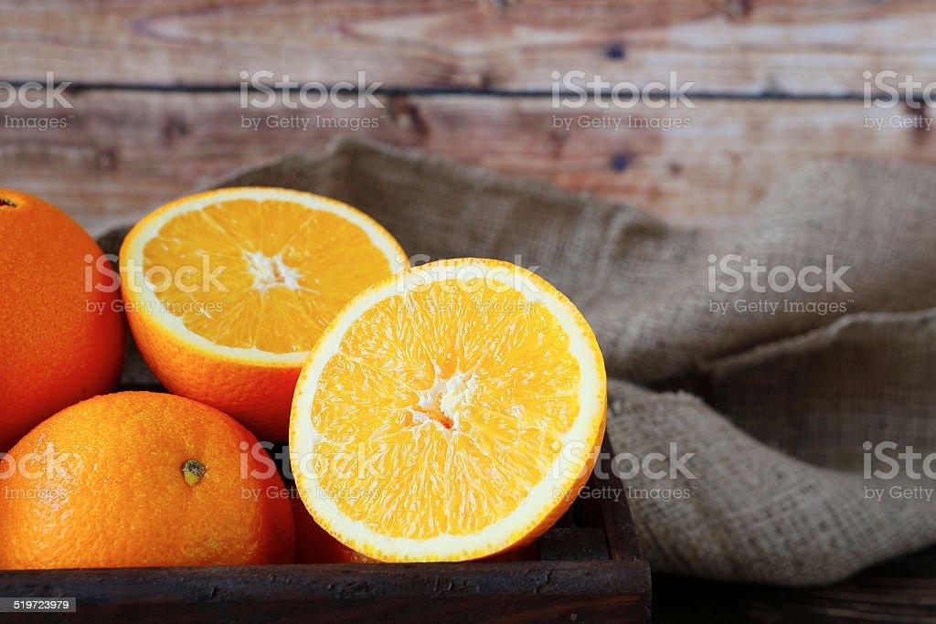 ripe orange in a wooden crate stock photo