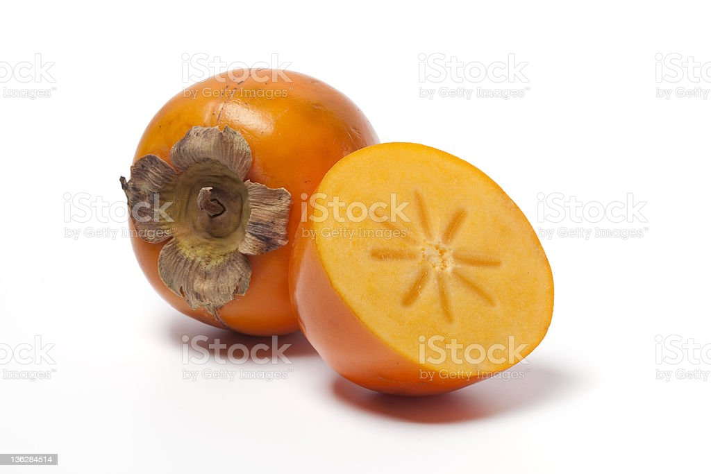 Ripe orange persimmon against white background stock photo