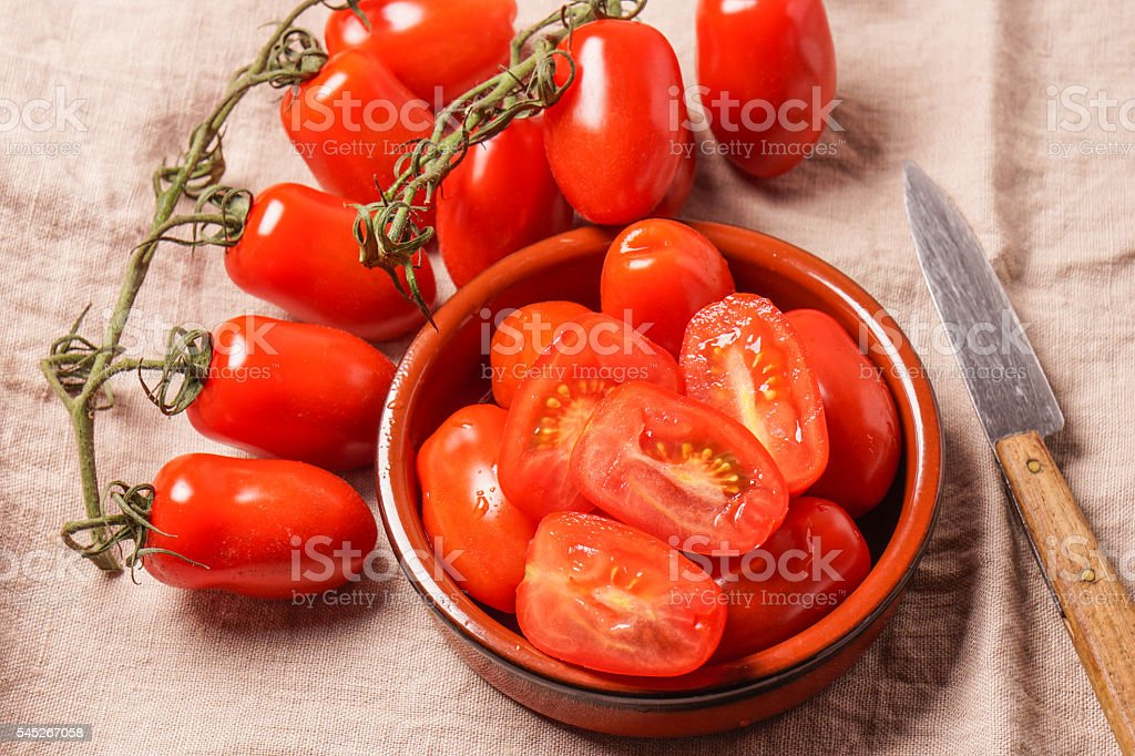 Ripe Organic red plum tomatoes stock photo