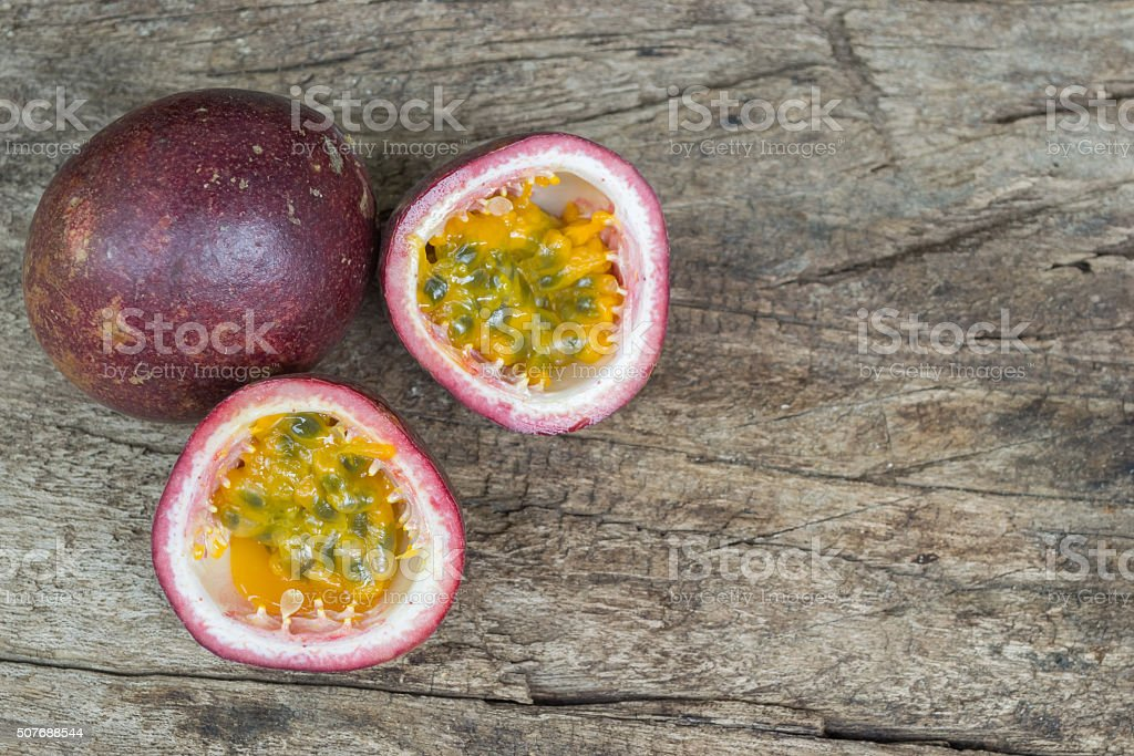Ripe passion fruit isolated on old wood background. stock photo