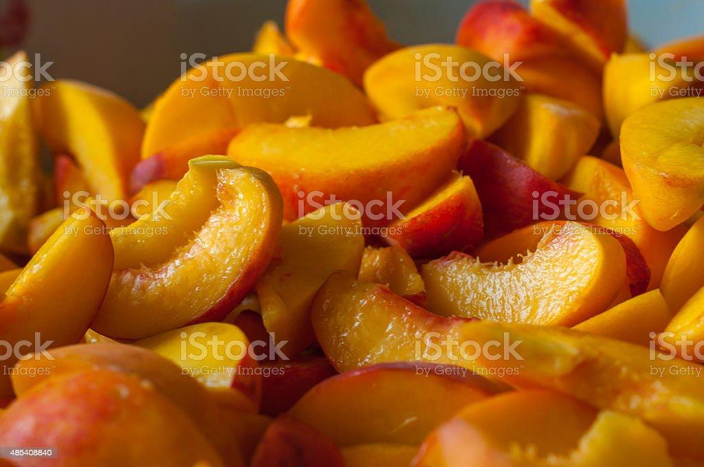 Ripe peach slices. Fresh organic fruits. Cooking jam stock photo