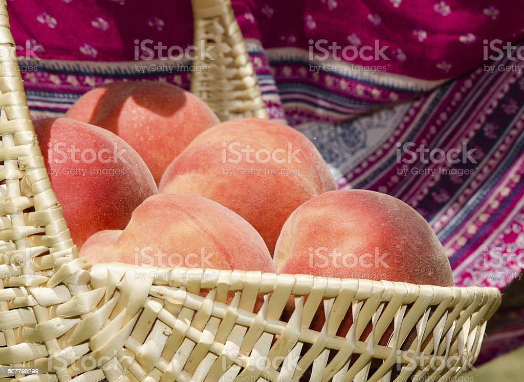 Ripe peaches in the basket stock photo