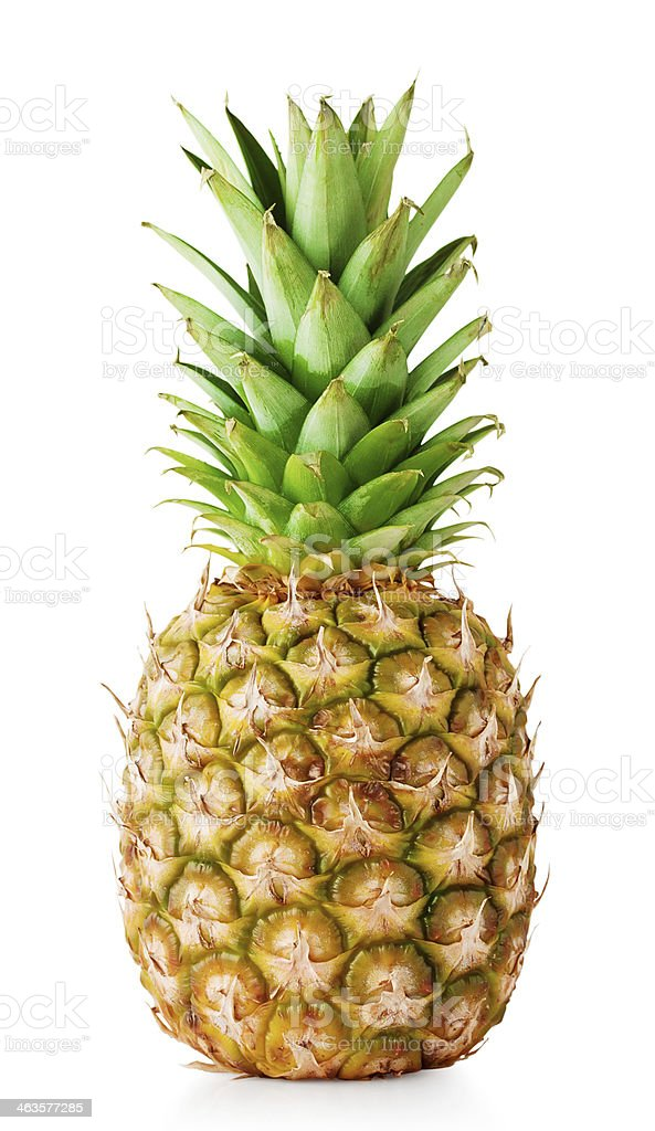 Ripe pineapple with green leaves stock photo